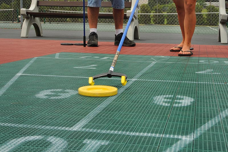 4 all weather shuffle board courts located at west entrance lake