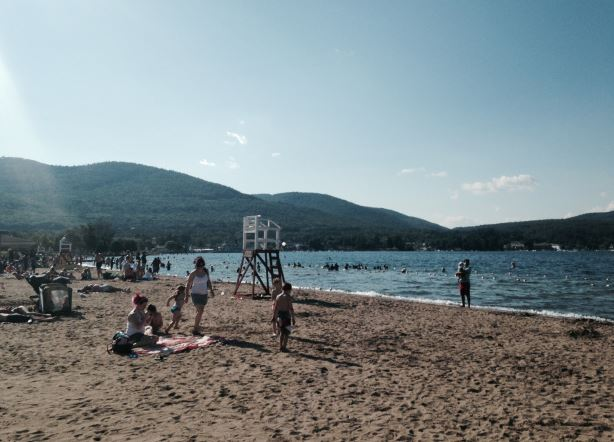 Relax at Million Dollar Beach in downtown Lake George