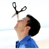 Bryson Lang balancing pointed scissors on his nose with a beach in the background