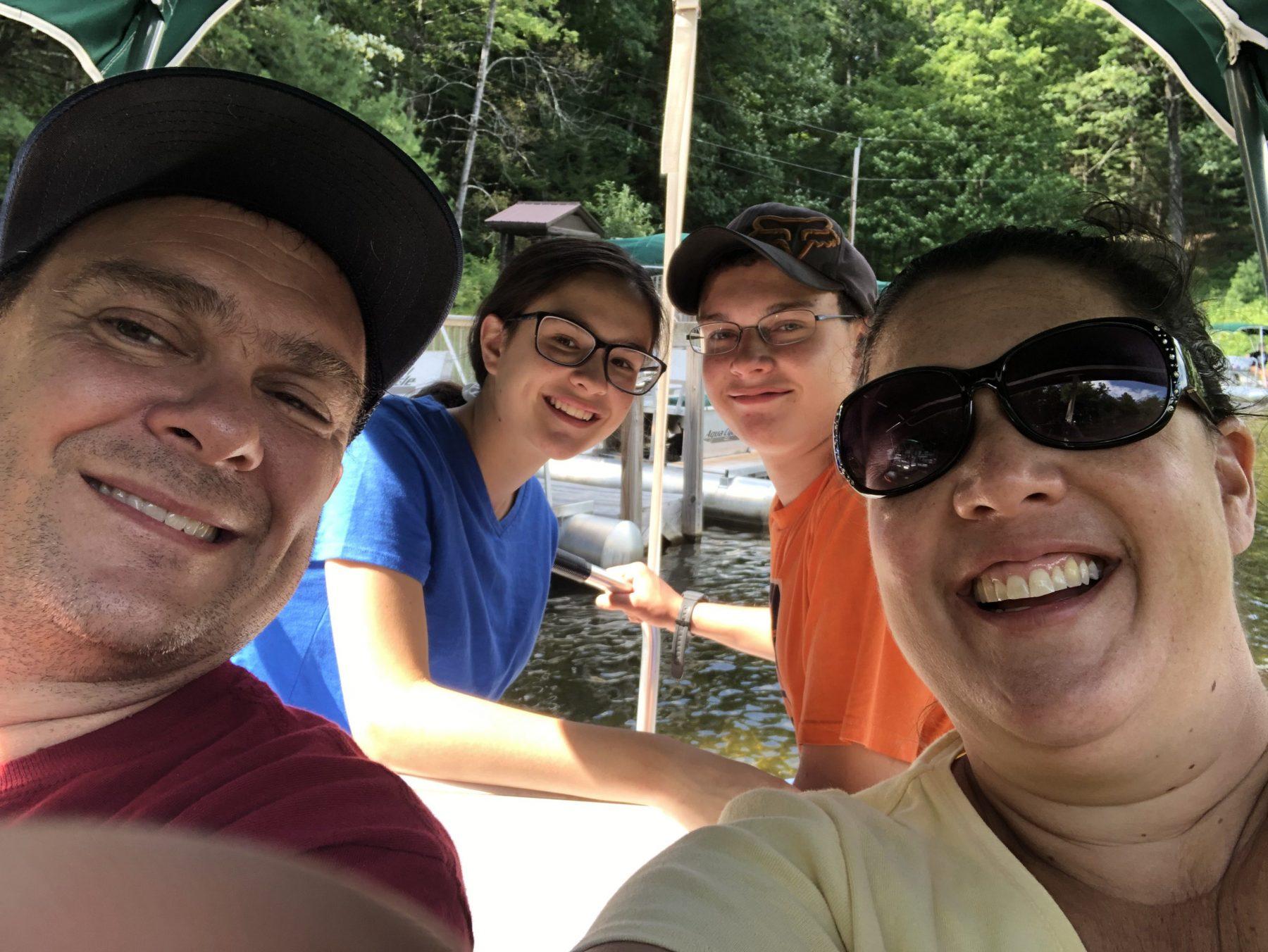 family posing for selfie