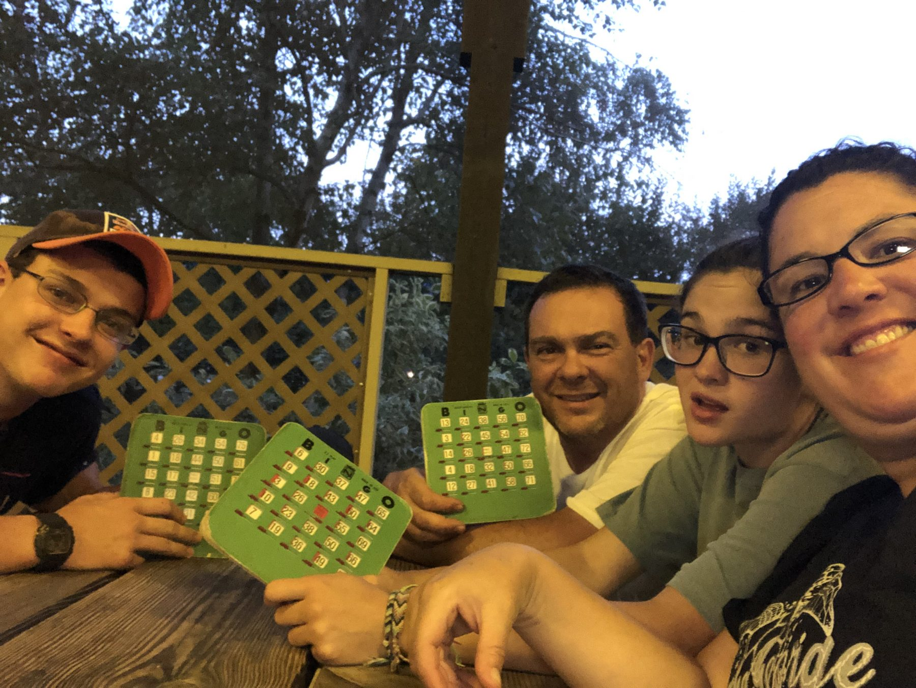 family playing a game at a picnic table