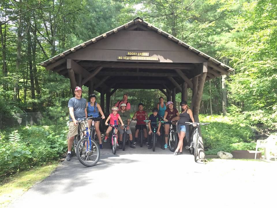 Group of bikers stopped on covered bridge