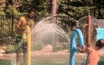 Dad and son firing water jets at each other