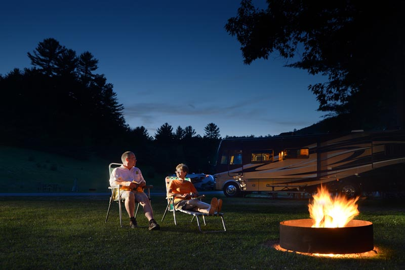 Couple gathered around fire pit
