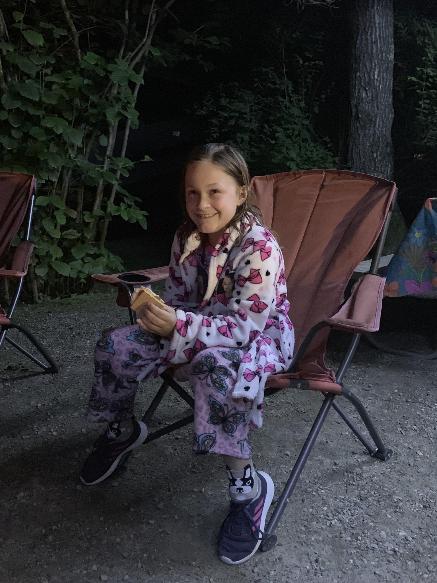 girl in PJS sitting in lawn chair