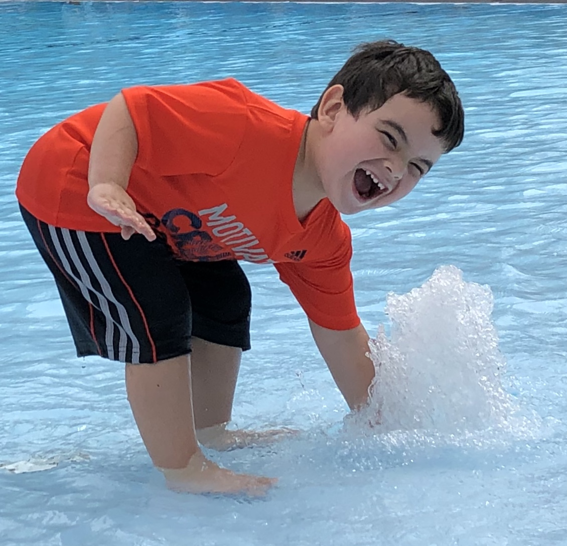 Kid feeling the water