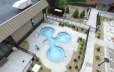 A birds eye view of Cascade Cove's hot tub area. 3 tubs are shown surrounded by a landscape area.