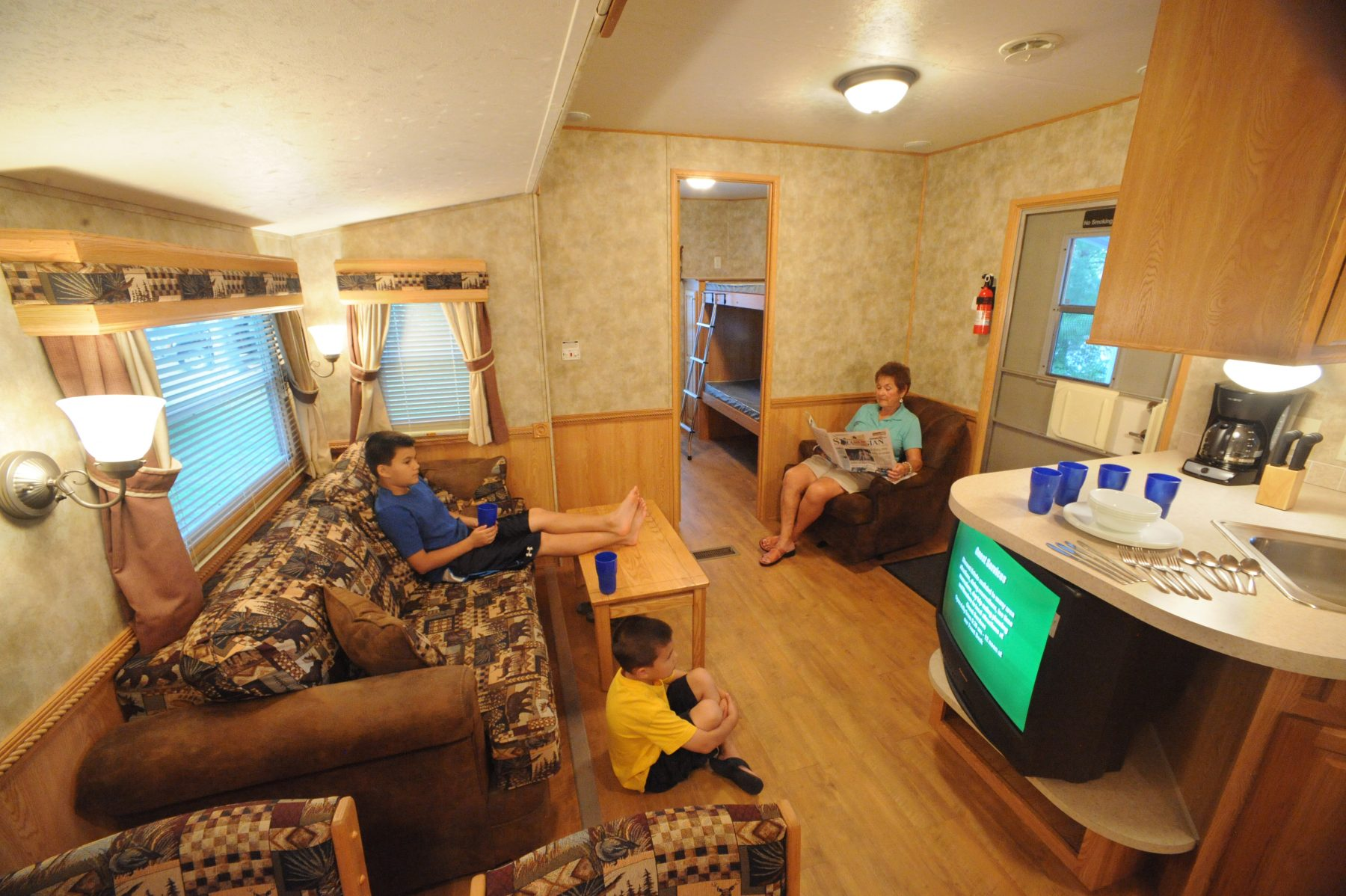 Family enjoying quiet time inside RV trailer