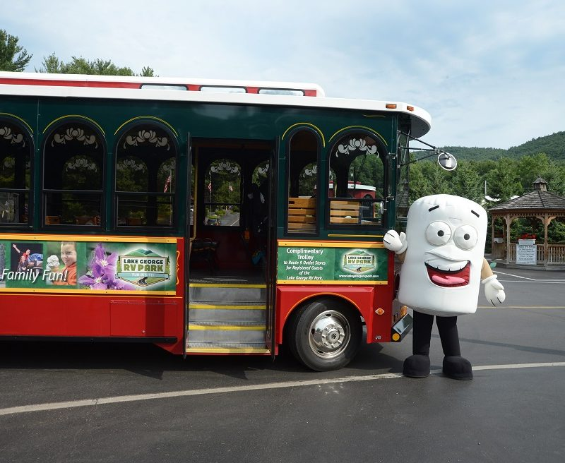 Mascot showing off trolley