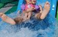 Kid and daughter on waterslide