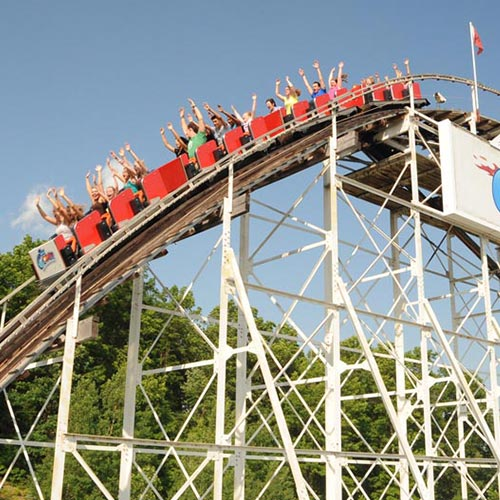 "People riding the roller coaster called the ""Comet"" at the Great Escape Amusement Park"