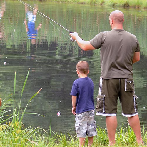 Father and son fishing in our fishing pond