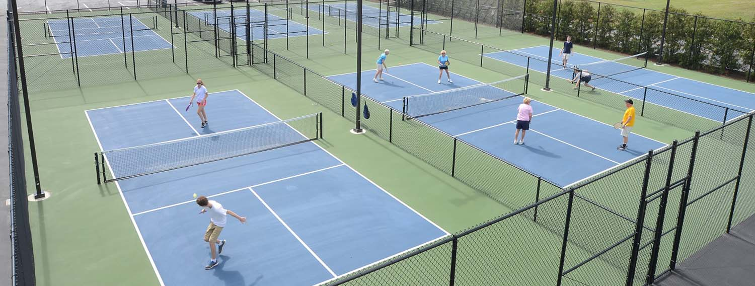 Guests playing at our pickle ball courts