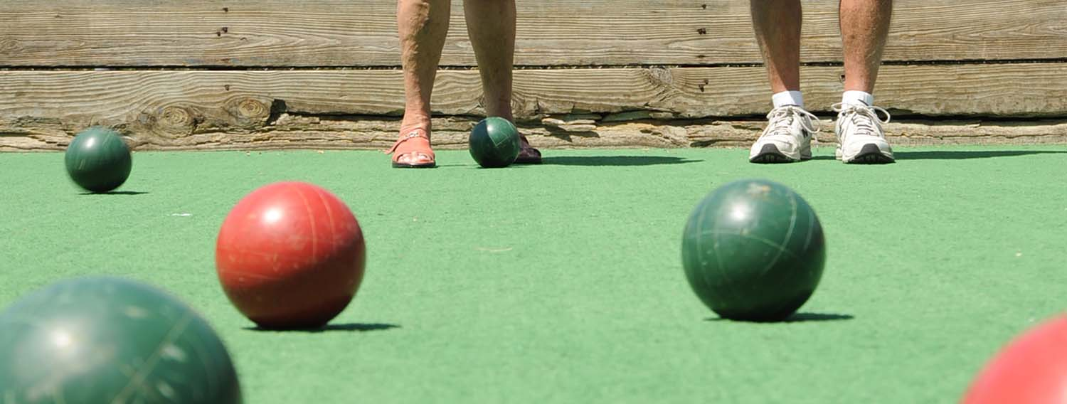 Guests playing bocce ball on our bocce ball court