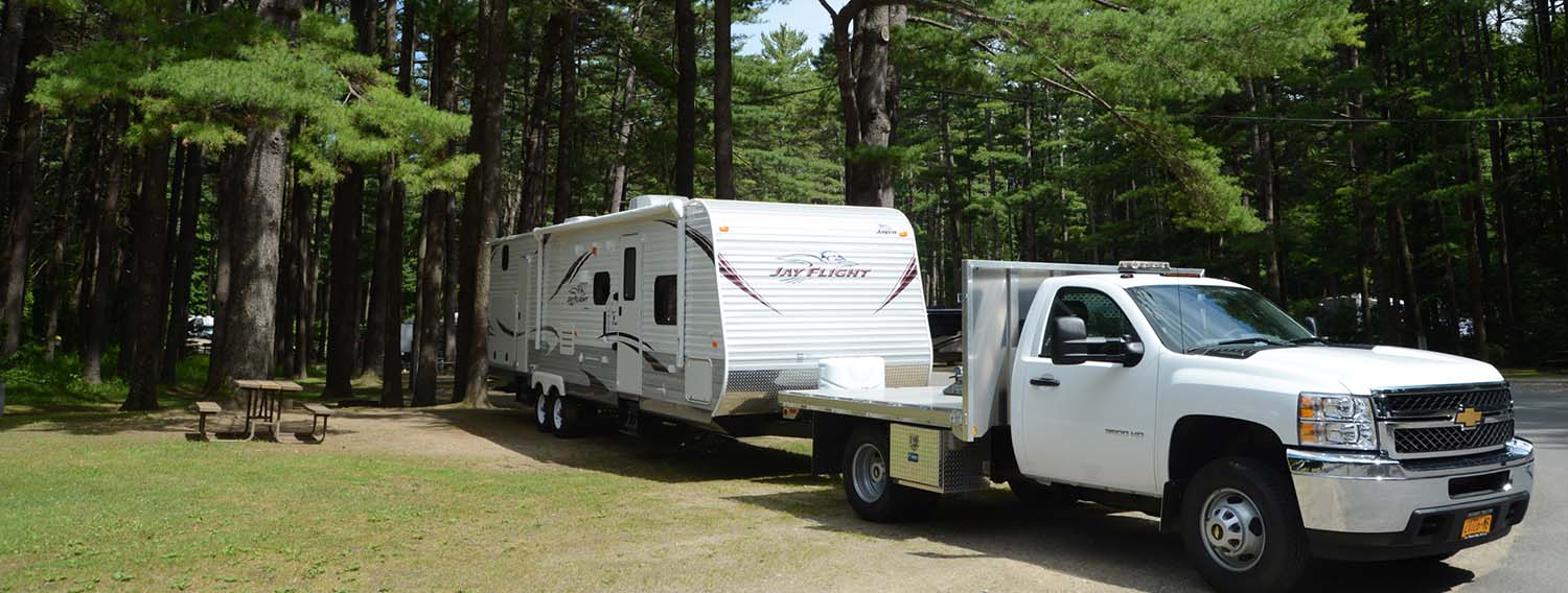 RV trailer backing into campsite