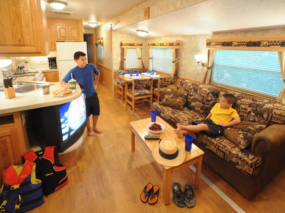 Kids relaxing Inside RV Tailer