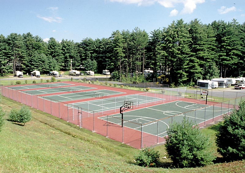 View of our four tennis courts and one of our basketball courts located on east end of park