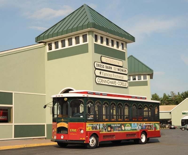 Trolley in front of shopping center