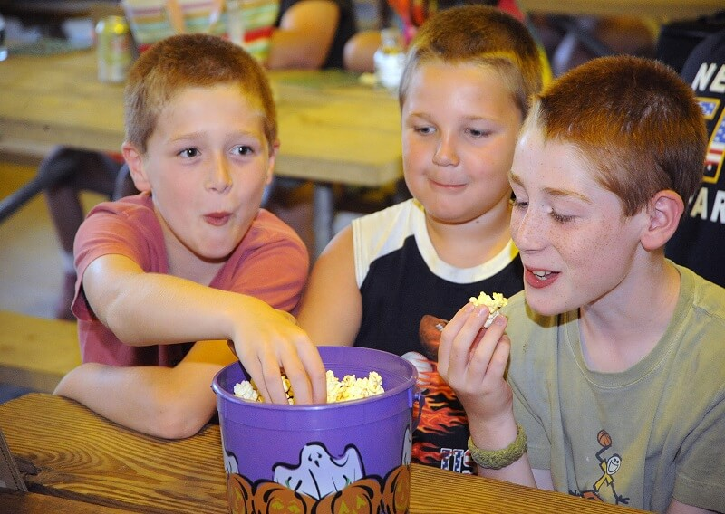 Children enjoying a snack during bingo