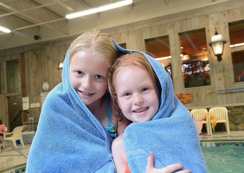 Children drying off in a towel at our indoor pool area