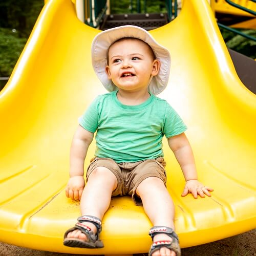 Toddler at the end of slide