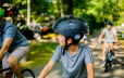 Young boy on his bike wearing a spiky helmet