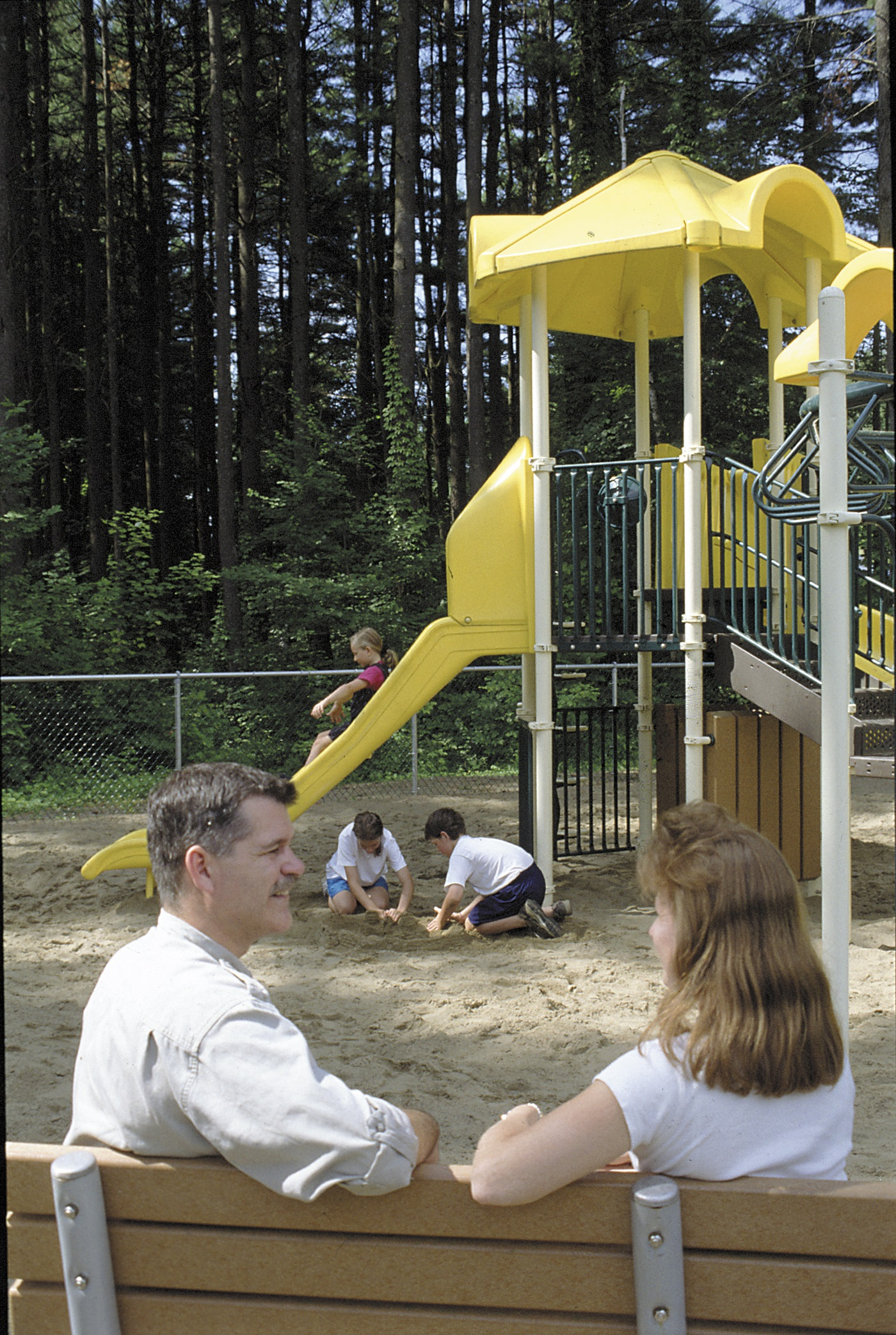 East end playground with yellow slide
