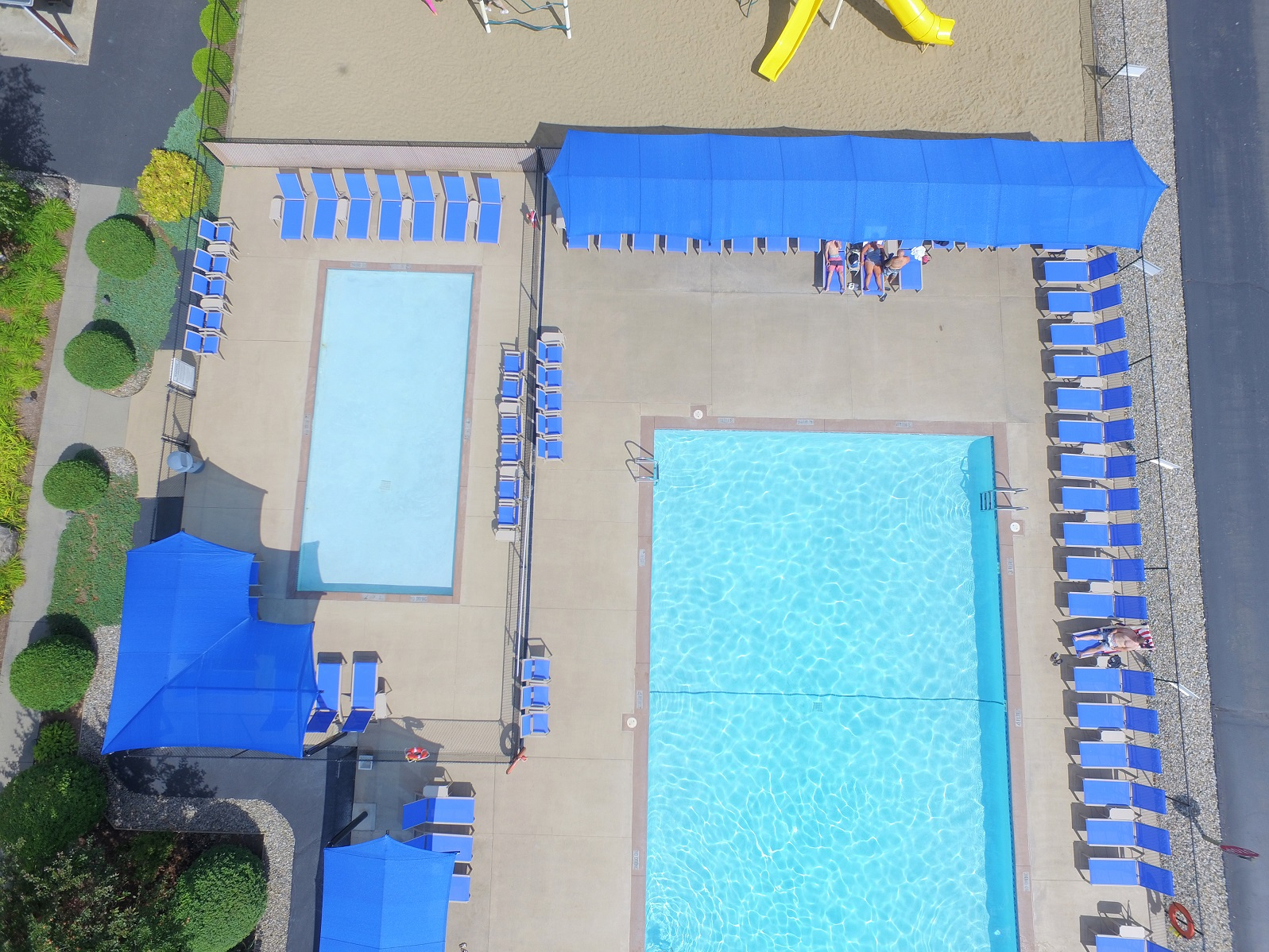 aerial view of west outdoor swimming pool in bright sun