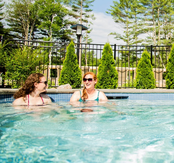 2 women enjoying hot tub