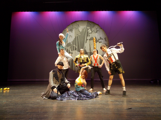 French Mountain Playhouse artists, Acrobats of Cirequetacular. The 7 artists are dressed in miscelleanous outfits and posing on stage.